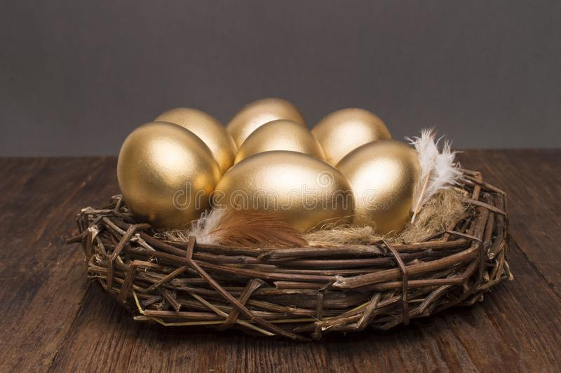 nest-golden-eggs-wooden-background-concept-successful-retirement-nest-golden-eggs-wooden-background-111598157.jpg